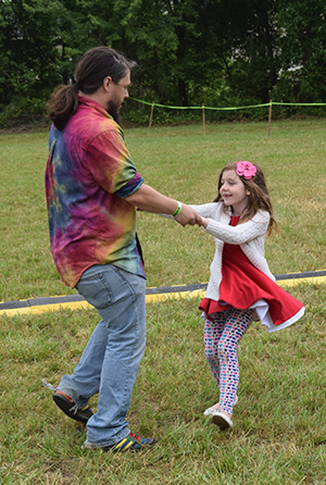 Dad and daughter dancing at South Jersey Arts Fest