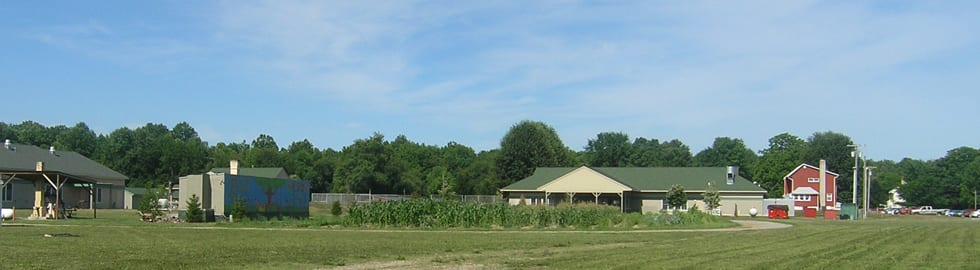 Panoramic view of Appel Farm on-site garden, dining hall, and main office building.