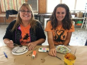 Mother and daughter participating in visual arts activity during Dream retreat.