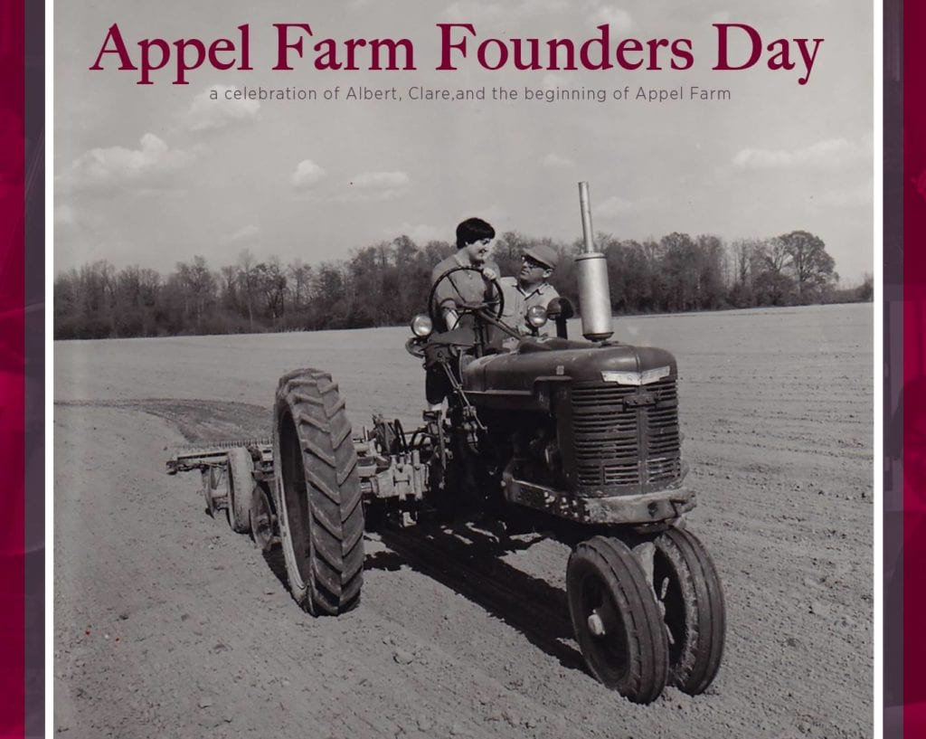 Appel Farm Founders Clare & Albert Appel riding together on a tractor on Appel Farm grounds